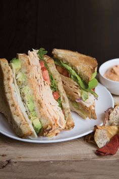 Ingredients for the best club sandwich ever: D&W Originals Oven Roasted Chicken Breast, tomato, avocado, lettuce, onion, sprouts, red pepper, and homemade Sriracha Mustard hummus.