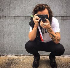 Imagine Harry taking pictures of you and when he shows you he jokingly complements every picture and you look at each other and smirk and you tell him to stop.