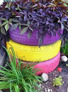 Painted Tire Planter - My mom had a couple or plain tire planters out front, but I love these would add great fun pops of color to the yard!