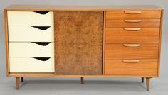 Harvey Probber credenza with burled sliding doors and bank of five exterior drawers having four interior drawers and three shelves, main wood mahogany ~ Realized Price $720.00