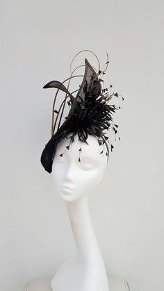 Striking black hatinator.Gold Fascinator.Wedding Headpiece.Mother of the Bride Hat. Wedding fascinator.Royal Ascot fascinator.Kentucky Derby by JayneAlisonMillinery on Etsy https://www.etsy.com/se-en/listing/571745552/striking-black-hatinatorgold