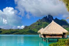 This overwater bungalow was first conceived and built in Tahiti in 1967 by three American hotel owners who took the traditional Polynesian huts and set them on concrete stilts over the water's edge.    Have any of you been to the beach recently? We'd love to know in the comments!