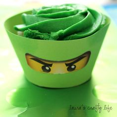 Brilliant way to dress up cupcakes for a certain theme--Ninjago cupcakes! Just cut out and glue the eyes onto the color/ninja of choice! top it off with matching icing.