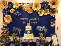 Paper flowers done with royal blue and gold cardstock. Goes well for a prince theme birthday party or baby shower.