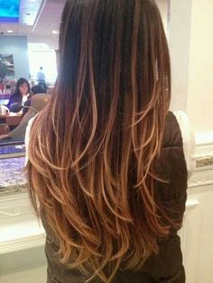 V-shaped hair with long layers. Also love the color!