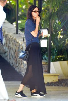 Keeping her cool: Friends star Courteney Cox, 53, flashed a hint of her bra and legs in a ...