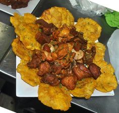 Carne frita tostones (fried pork pieces with fried green plantains)