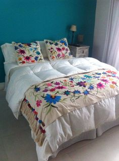 place grandma's embroidery in middle of bedspread?