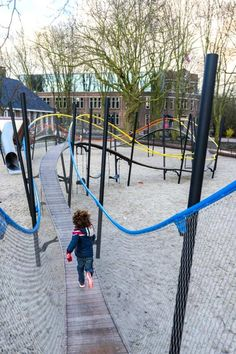 """Play Garland Oosterpark"" in Amsterdam, The Netherlands - photo by Marleen Beek, via Landezine; a 289' long ""garland"" that meanders up and down and around, with a slide on one end; designed by Carve"