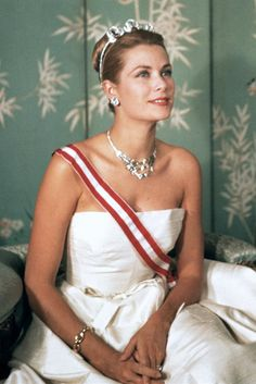 Grace Kelly met Prince Rainier III of Monaco in 1955. After a short courtship, he gave the actress a ruby and diamond band, and then he subsequently gave her a 10.47ct Cartier emerald cut diamond engagement ring. She was showered with Cartier bridal jewelry including a platinum and diamond necklace and tiara.