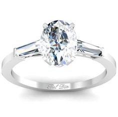 Oval three stone engagement ring.