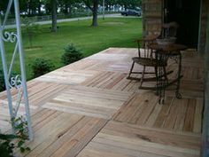 DIY: Budget Deck Made from Shipping Pallets. Would work on our patio.