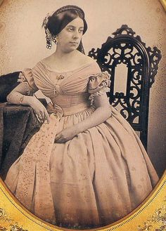 Photograph: Woman wearing a lovely evening gown. Love the bodice pleating and bow at the waist!!!