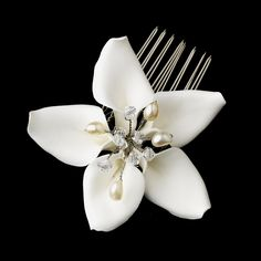 Truly elegant, this bridal comb features a lovely porcelain flower with creamy freshwater pearls and swarovski crystals at the center.