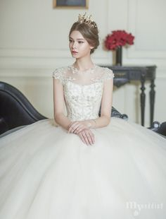 I like the poofy skirt. Isn't that faux neckline just ravishing?