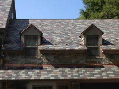 """Reading, PA hailstorm re-roof using our North Country Unfading Black, Unfading Green, Purple and Semi-Weathering Grey/Green 14"""" x random width x 1/4"""" - 3/8"""""""