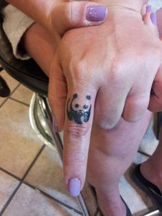Panda Bear finger tattoo