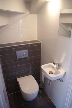 Under-stairs bathroom! LOVE IT, only I don't need another basement bathroom.