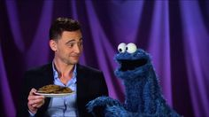 Tom Hiddleston and Cookie Monster