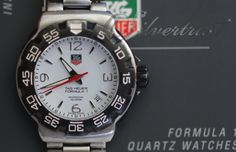 Brand: Tag Heuer R 6499 Movement: Quartz (Battery powered) Case: Satin finish solid AISI 316L Stainless steel Crown: Sport style, screw-down (threaded). Factory Logo engraved/embossed. Crystal: Sapphire. Flat profile. Dial: White color. Applied polished Silver color markers. Hands: Luminous hour markers/dots. Clasp: Tri-fold, Sport style, with security flip-lock and over-the-wetsuit expansion. Factory Logo engraved/embossed. Ref No: WAC1111-0 Diameter: 40 MM Band Material: Stainless steel