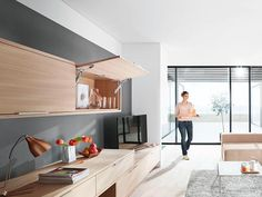 AVENTOS HK-XS used on two sides in the living room... When used on both sides, even larger, heavier fronts can be used with AVENTOS HK-XS