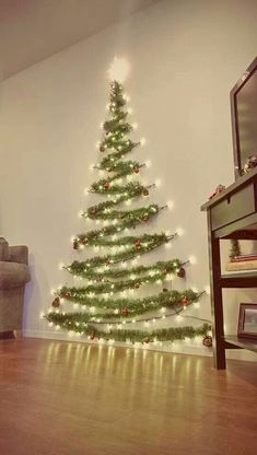 Easy Christmas Decor From simple to amazing Notable tips and tricks to form a fun and charming simple christmas decor diy xmas trees . Xmas image provided on this day 20190114 , exciting post reference 3707337813 Wall Christmas Tree, Noel Christmas, Xmas Trees, Christmas Tree Made Of Lights, Tinsel Tree, Outdoor Christmas, Christmas Tree For Apartment, Christmas Tree Ideas For Small Spaces, How To Decorate For Christmas