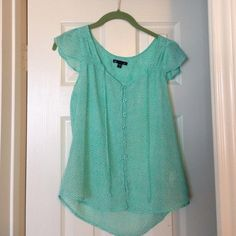 2 Gap shirts. Mint green blouse and polka dot tee. Airy blouse with pretty scallop pattern. Perfect for summer! Pair with jeans or a pencil skirt. Smoke-free home! Grey with gold polka dot tee. Very cute. I can't go lower than $9 unless bundled. GAP Tops Blouses