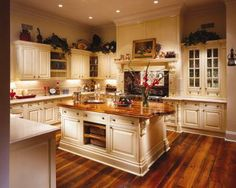 white kitchen with wood island and floors