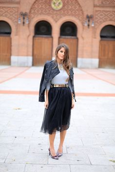 Jessica Chanes of Seams for a Desire adds an edge to her look with a leather jacket // The Feminine Skirt All The Bloggers Are Wearing