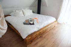 Rustic Modern King Bed by Chivarean and White Bed Linen from
