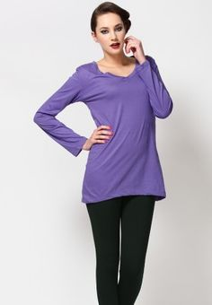 Casual, purple coloured top for women by Silverswan. Made from stretchable cotton spandex, this hip-length top has full sleeves, regular fit and a V-neck.