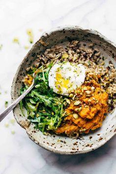 Healing Bowls: turmeric sweet potatoes, brown rice, red quinoa, arugula, poached egg, lemon dressing.   http://pinchofyum.com