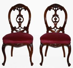 A very good set of mid Victorian, walnut, balloon-back chairs with fretted and carved splats and upholstered in a cranberry colored cotton velvet fabric