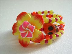 Day of the Dead Orange Skull Polymer Clay Flower by OctoberPetals
