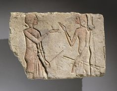 Relief of Men Talking. These two men wear costumes and carry clubs that identify them as guards or policemen. Note how the artist represented them gesturing with their hands, as if each were trying to emphasize his point. Limestone, painted. ca. 1352-1336 B.C.E., late XVIII Dynasty, Amarna Period. Brooklyn Museum