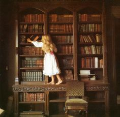 Little girl looking for a good book.
