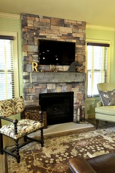 Drystack cultured stone, a reclaimed barn beam mantle, and a high efficiency gas log fireplace.  www.jsbrowncompany.com