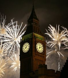 Fireworks explode over Elizabeth Tower housing the Big Ben clock to celebrate the New Year in London, Tuesday, Jan. 1, 2013.(AP Photo/Kirsty Wigglesworth)