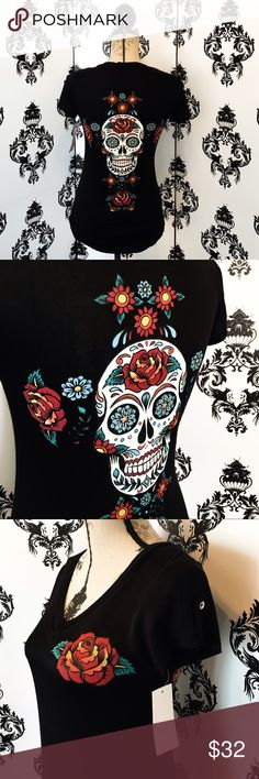 NWT! Gorgeous Sugar Skull Stretchy V~Neck Top! This shirt is absolutely gorgeous with the beautiful rose printed on the front and the Vibrant colors of the sugar skull printed on the back with colorful flowers and silver sparkly gems! The sleeves have a beautiful accent piece with a pretty silver button. The material is soft and light and also very stretchy for a perfect fit! Brand new! Smoke free home. Tops Tees - Short Sleeve