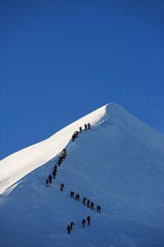 Long line of climbers on summit ridge of Mont Blanc, 4810m, Chamonix, French…
