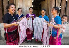 THASONGYANG, TAK , THAILAND - DEC4 : Women Karen hill tribe are showing of the natural fabrics dyeing work before sent to distributer in the city  at Thasongyang, Tak, Thailand on DECEMBER4, 2014 - stock photo