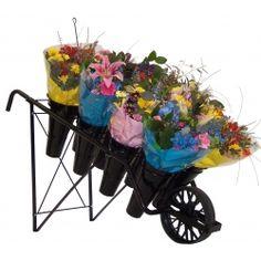 Expositor Carretilla para ramos de flores. 8 Floreros de plásticos incluidos. Estructura metálica en color negro.