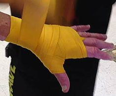 FightingArts.com - How To Wrap Your Hands: For Boxing, Kick Boxing, Mixed Martial Arts, Karate and Other Contact Punching Arts