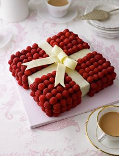Jewel Box Cake- this is a square white chocolate sponge cake, completely covered with small raspberries and decorated with white chocolate ribbons, tied to look like a beautiful jewel box. Cake Recipes, Dessert Recipes, Chocolate Sponge Cake, Box Cake, Fancy Cakes, Pretty Cakes, Cream Cake, Creative Cakes, Cake Toppers