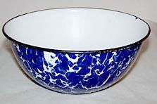 Here is a very nice graniteware or enamelware bowl in the cobalt and white large swirl pattern. It measure 8.5 inches across and is 3.5 inches deep. This bowl is in very nice condition with only the o