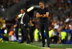 Brendan Rodgers manager of Celtic and Luis Enrique manager of Barcelona watch on during the UEFA Champions League Group C match between FC Barcelona and Celtic FC at Camp Nou on September 13, 2016 in Barcelona, Catalonia.