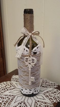 Rustic Wine Bottle Vase with burlap lace by WhyWastetheWine, $20.00