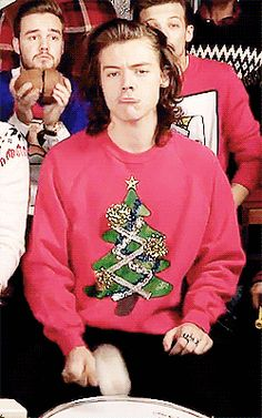 Harry in an ugly Christmas sweater... And still looks like a freaking Greek God.