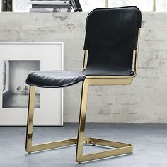 The Rake Brass Chair is a fashion-forward pairing of supple leather and slick metal. Gleaming brass-plated steel frame is outfitted in a genuine black leather sling that slips on and off like a glove to create two distinct looks. Black Dining Chairs, Modern Chairs, Kitchen Chairs, Modern Furniture, Wood Furniture, Antique Furniture, White Chairs, White Furniture, Outdoor Furniture