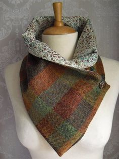 Handmade Scarf/Snood made from Genuine Harris wool tweed with a super soft Liberty Tana lawn lining which compliments the tweed beautifully. Ideal for keeping your neck warm without the bulk of a normal wool scarf. Buttons to the side with a wooden button and has a hidden popper finish on the inside. A truly stunning new Harris tweed. As you can see from the photos the colours are just beautiful....far too many to mention!! The snood can be worn two ways with or without the lining show...